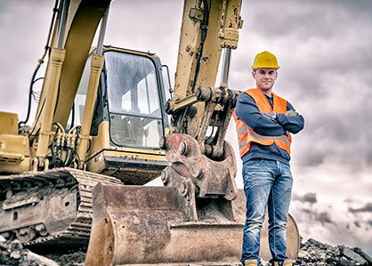 Construction worker beside equipment looking for accounting help